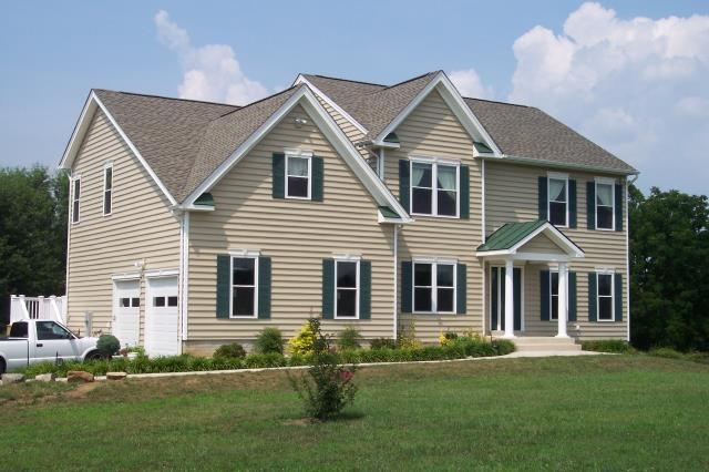 Dundee, Angus - Completed all exterior - roof, siding, windows, and door, along with standing seam metal porch roof.