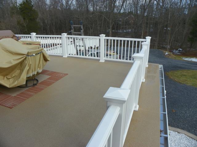 Haymarket, VA - Resurfaced whole back surface with Duradek high quality vinyl decking.