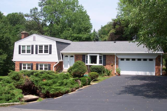 """Vienna, VA - Roof replaced with GAF Timberline HD shingles and also replaced the 5"""" white seamless aluminum gutters."""