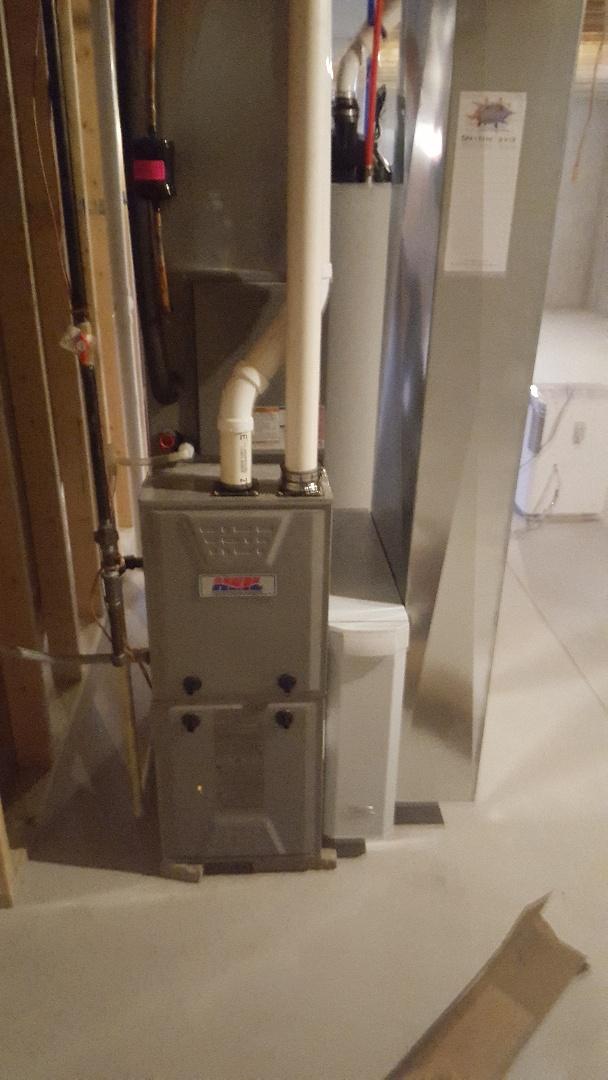 Belgium, WI - Performing seasonal efficiency agreement on Heil high efficiency gas furnace