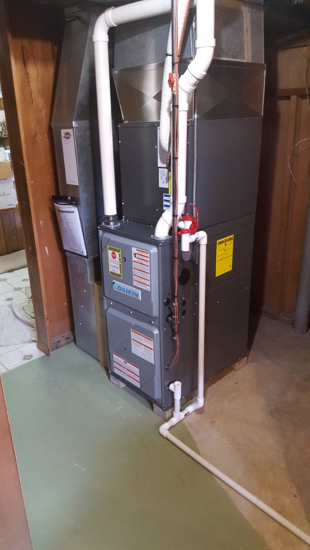 Port Washington, WI - Daikin high-efficiency two-stage gas furnace installation with high efficiency air filter and AC trap