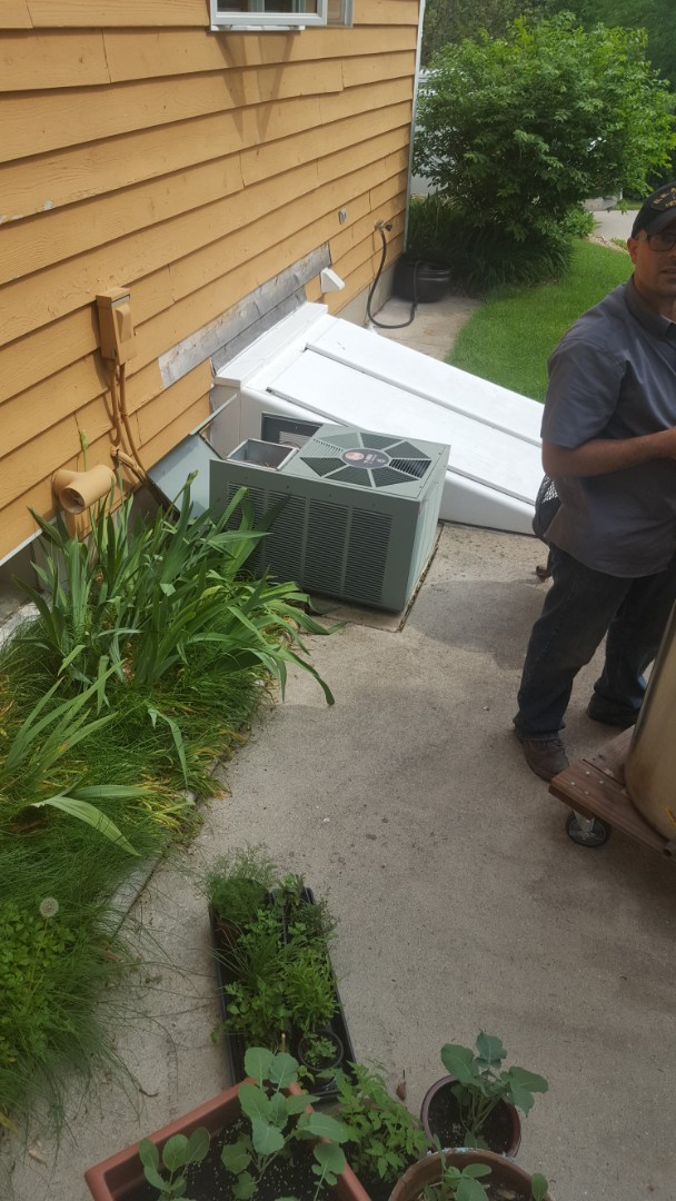 Saukville, WI - Repairing Rheem air conditioner in ultramax furnace