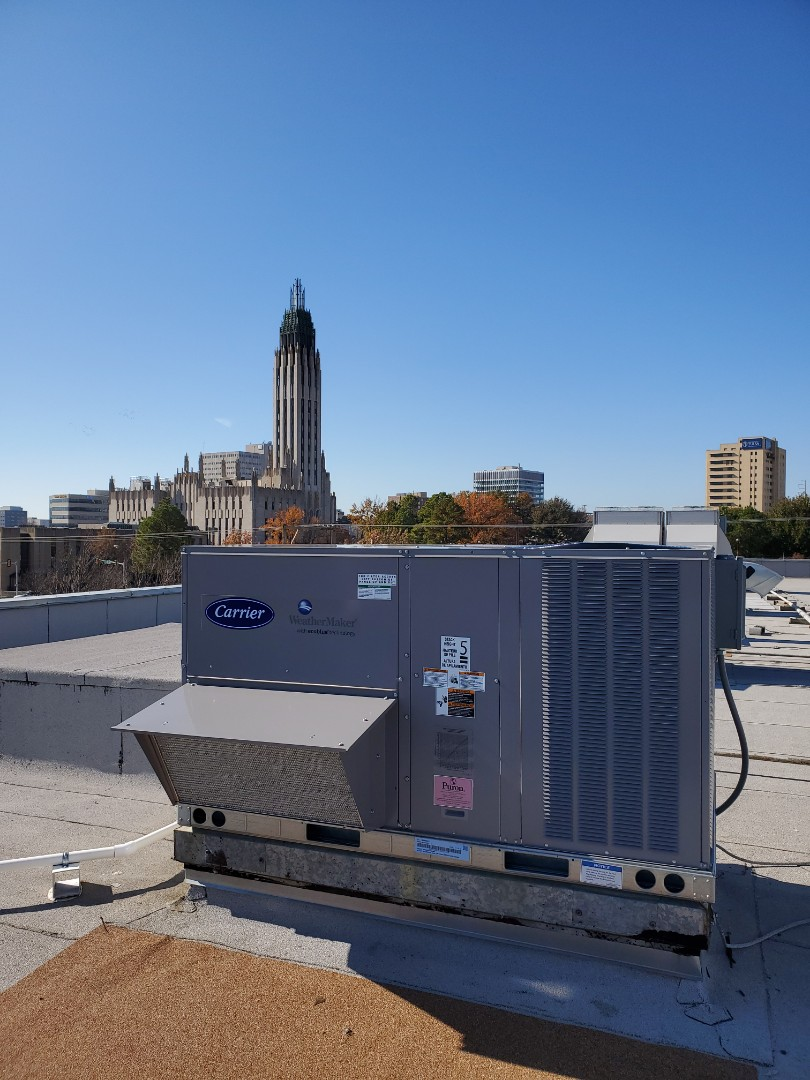 Installing new 6 ton Carrier rooftop unit in Downtown Tulsa.