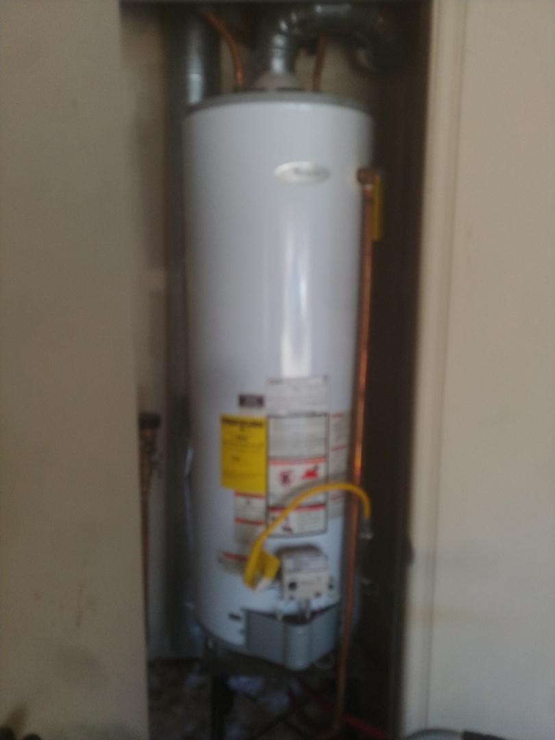 installing new hot water tank at customers house in Broken Arrow