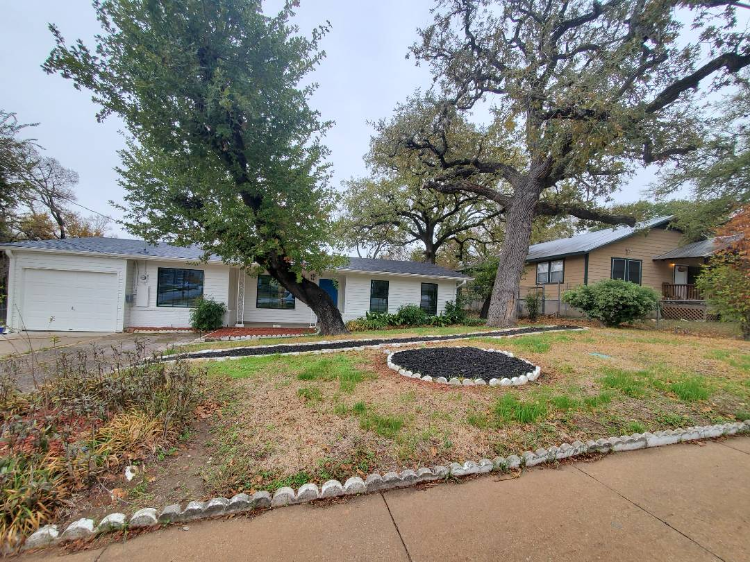 Austin, TX - Big TRANSFORMATION of this Home, when compared to the neighbors house which is what it used to look like!