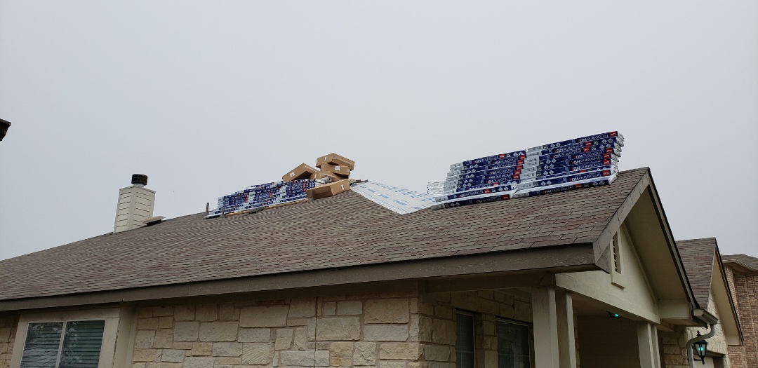 Pflugerville, TX - Checking on our roof that was supposed to be installed today, hope to get a green light to work and keep this home from leaking. The cease to work order has us at a stand still at the moment.