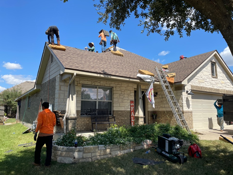 Leander, TX - Installing GAF Barkwood shingles. Paid for by insurance.  Mike and Ronnie