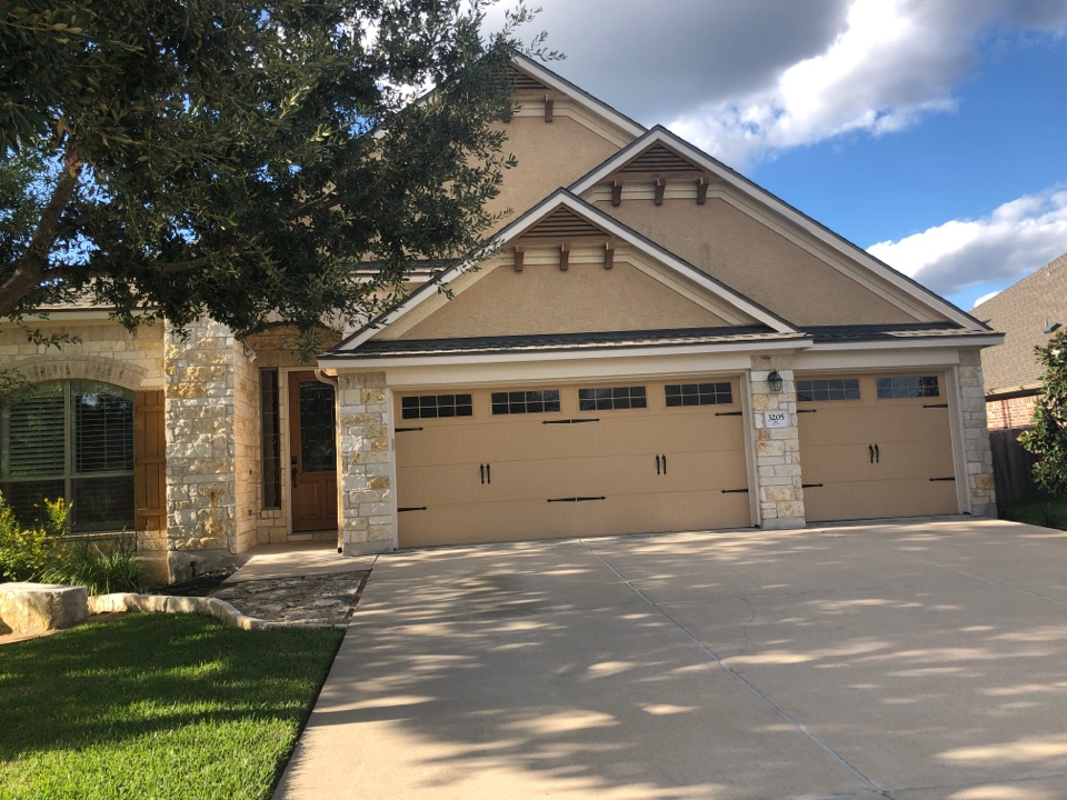 Austin, TX - Picked up final check for new roof replacement in Leander