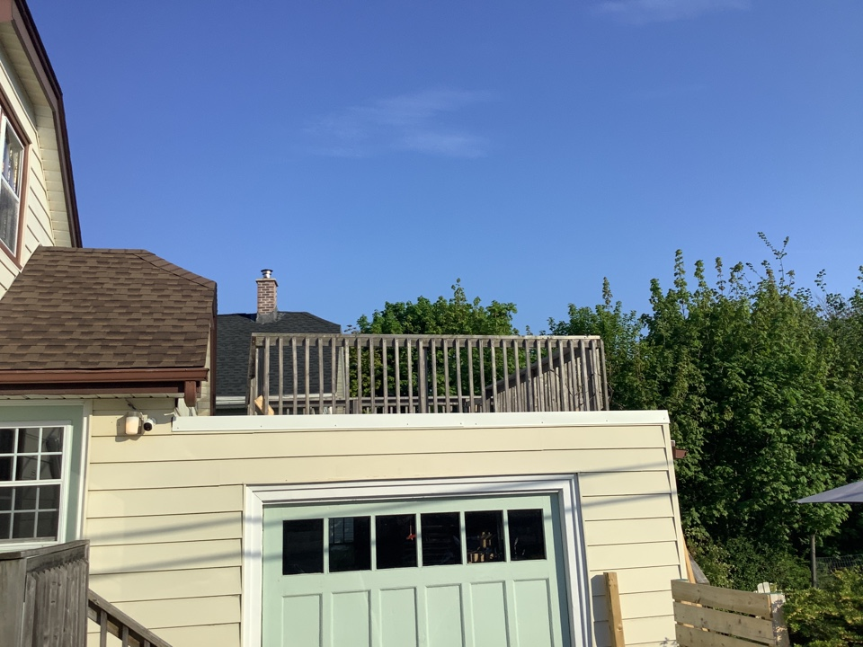 Woodside, NS - GACO roof coating under deck & replaced metal cap to white