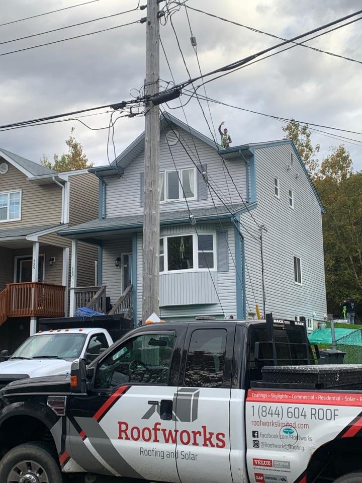 Bedford, NS - Roofworks installing new GAF asphalt roof shingles. Unlimited wind warranty.