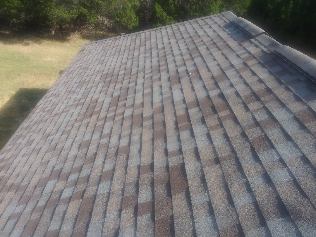 Liberty Hill, TX - Finish up on Owens Corning Tru-Def roof in Liberty Hill. Limited Lifetime Laminate composition shingles.