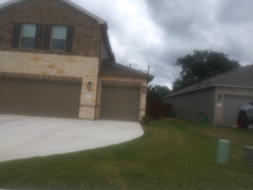 Liberty Hill, TX - Roof inspection of wall flashing for kick out flashing.