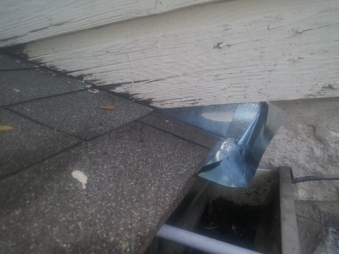 Austin, TX - Installing kick-out diverter to steer water out away from Wall and into gutter. North Austin