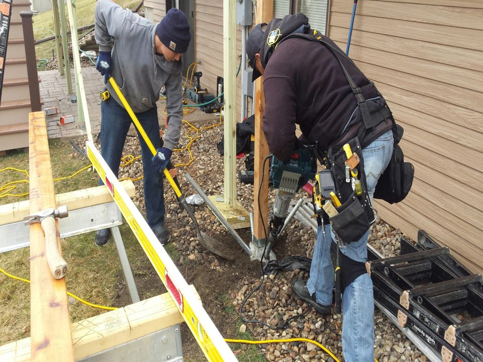 Bismarck, ND - The boys setting footings on a New Deck in Bismarck
