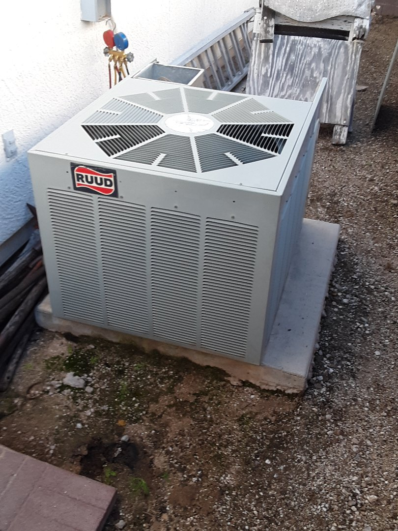 Tucson, AZ - Working on a split air conditioner, change out today in east Tucson. Replacing their Rudd units with an environment friendly Goodman 410A unit.