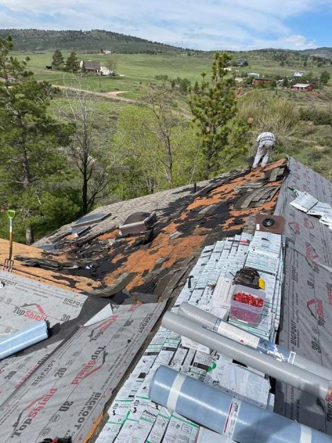 Berthoud, CO - Tearing off a roof due to hail damage! Replacing the roof with Atlas Pinnacle Pristine.