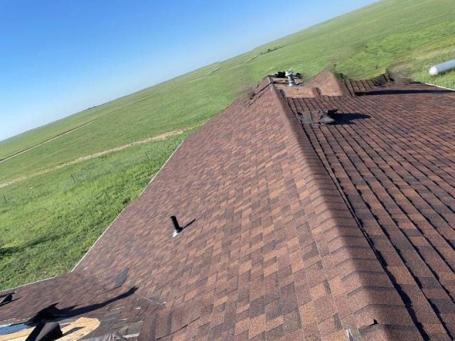 Yoder, CO - Damage roof, helping out this client replace his roof with Owens Corning Estate Grey