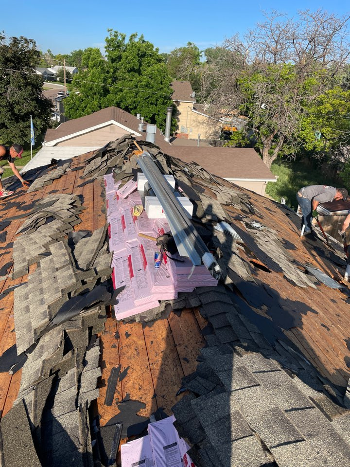 Northglenn, CO - Replacing the entire roof! This roof had a lot of hail damage, we are tearing off all layers of shingle and replacing it with Owens Corning Oakridge Estate Gray!