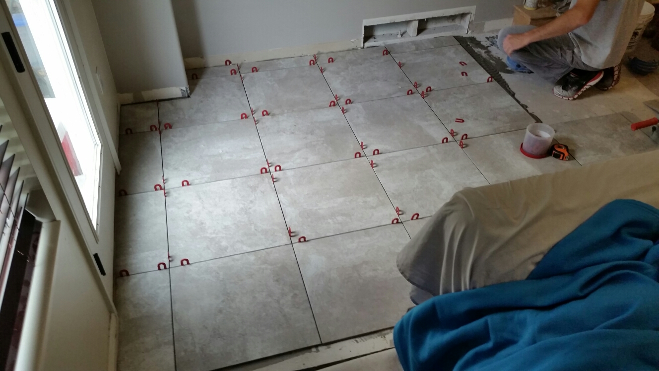 Draper, UT - More progress being made today on the new tile floor in this draper home, hopefully grout can be done tomorrow!