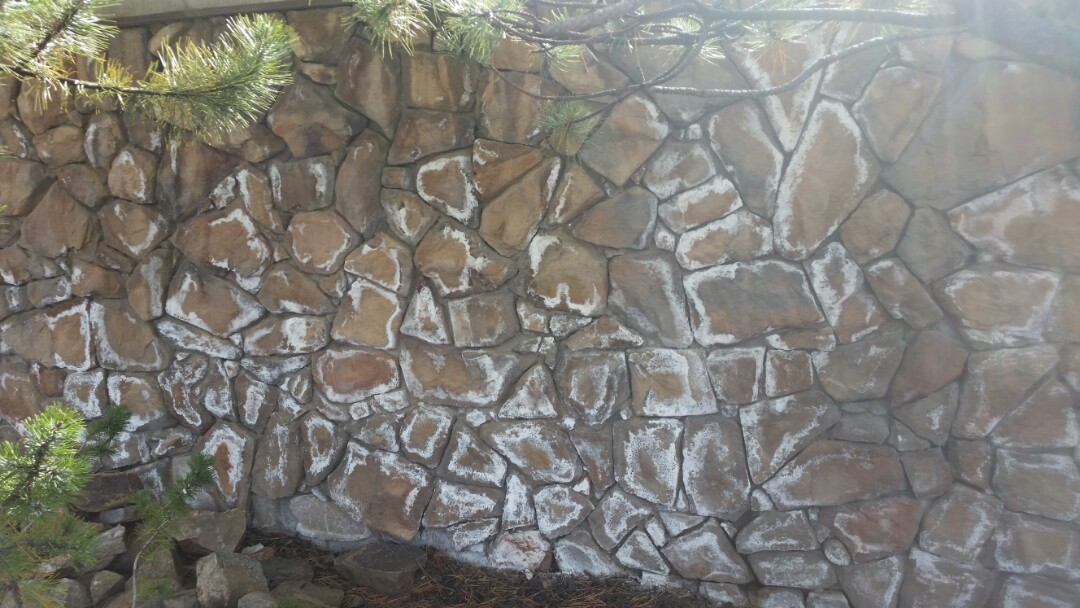 Park City, UT - Water damage and mold inspection in Park City, Utah. The white staining on this rock wall is called efflorescence, which means there is a lot of moisture migrating through this wall. When the moisture evaporates it leaves behind some of the dissolved minerals and salts. 801-294-7452 http://www.thefloodco.com/