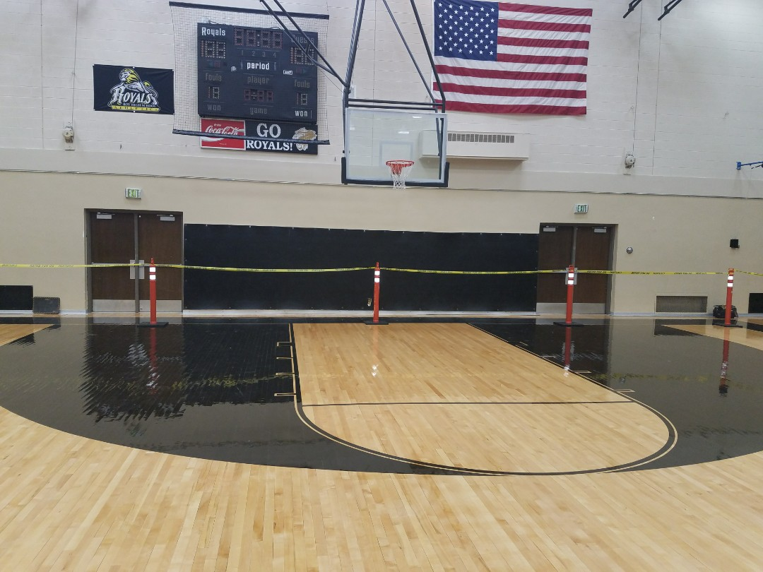 Roy, UT - Water damage consulting in Roy, Utah. The Roy High School gym floor has some cupping from water damage. Although the district has some of their own drying equipment, they don't have the training, experience or expertise to deal with a more technical dry out. And, if the floor can be saved, they don't want to screw it up so they are doing the smart thing to reach out for some professional advice.  801-294-7452  http://www.thefloodco.com/roy-utah.html