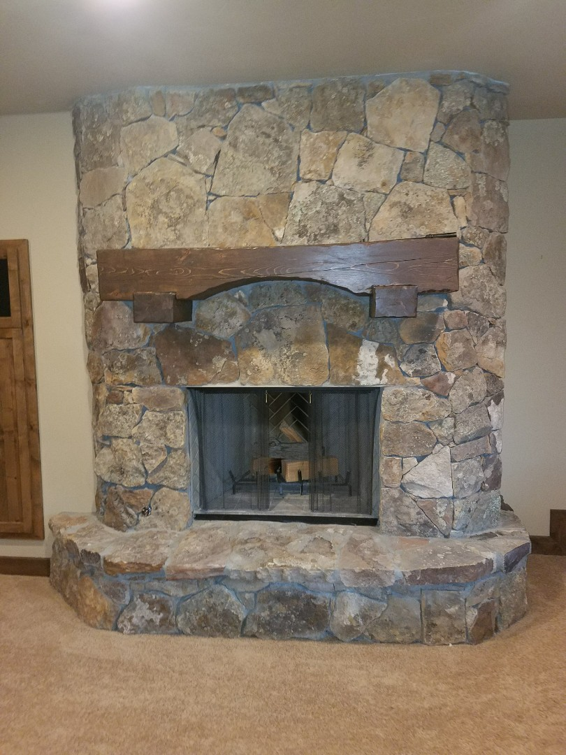 Bountiful, UT - Mold inspection in Bountiful, Utah. This is a nicely finished calm and a beautiful looking fireplace, we have not detected any mold issues. The rock on the fireplace actually has lichens on the rock as part of the character. Lichens are actually a parasitic growth that grows on top of mold but not a mold concern. Spores do not get airborne from lichens on rock. 801-294-7452  http://www.thefloodco.com/west-bountiful-utah.html