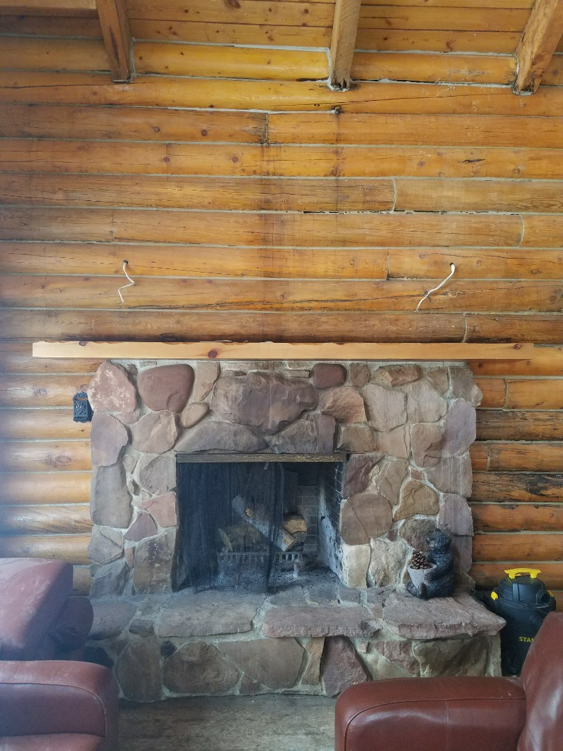 Park City, UT - Mold inspection in a cabin in the Park City area. This is a beautiful fireplace and a rustic log cabin with just the right atmosphere but the logs in this wall around the fireplace or rotted from long-term water damage. When logs are rotted there's no easy fix for mulled purposes and for log for structural purposes they need to be replaced. It's important to keep materials dry if they get wet fix the problem and dry things quickly.
