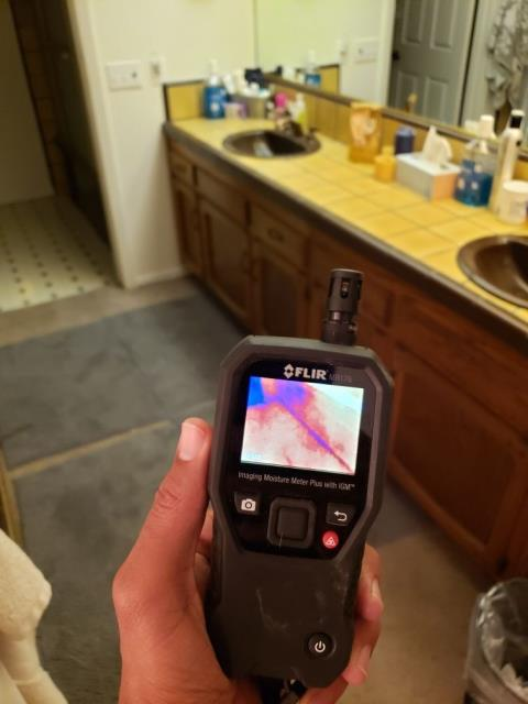 Escondido, CA - Homeowner reports noticing a moldy smell coming from their master bathroom, as well as the drywall bubbling. Performed water mitigation and mold remediation services.