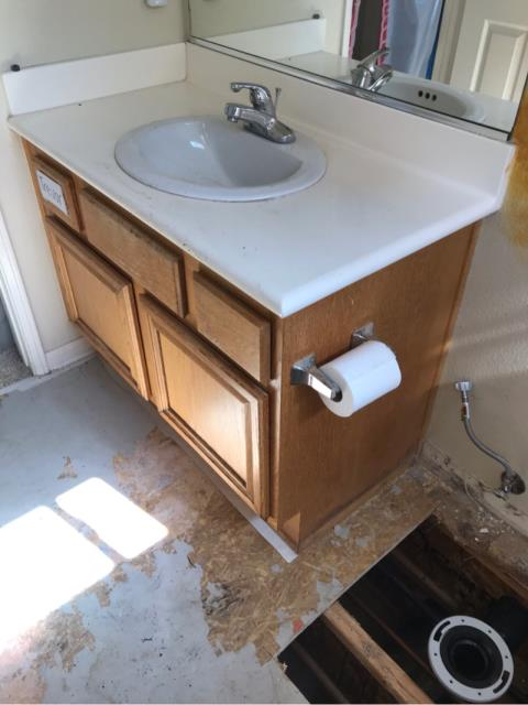 San Diego, CA - Upstairs toilet leak resulting in damage to the flooring in the bathroom. Performed water mitigation and restoration services to restore bathroom to pre-loss conditions.