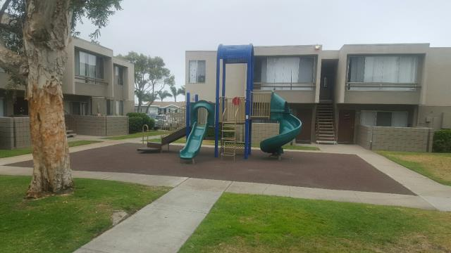 San Diego, CA - Apartment complex with 20 buildings and 250 units. Reframing and replacement of all windows and sliders in each unit. Replace rubber mat at the playground.