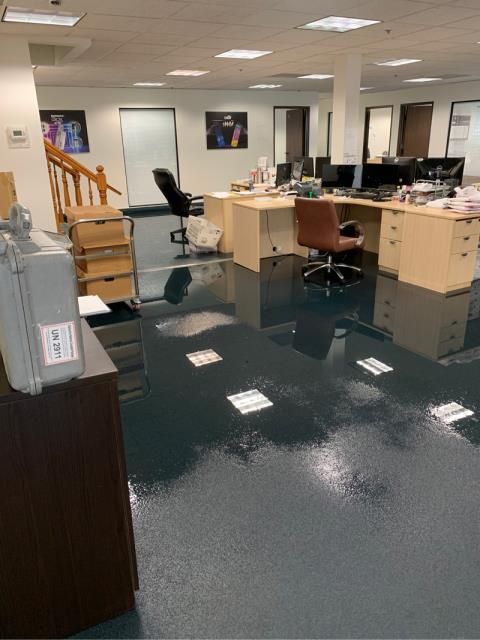 Costa Mesa, CA - Commercial office space 6,000 SF of space downstairs-- 3/4 of that is affected. Standing water. Offices and a warehouse directly affected.  Resicom provided water damage dry out services and restoration of the affected flooring and walls.