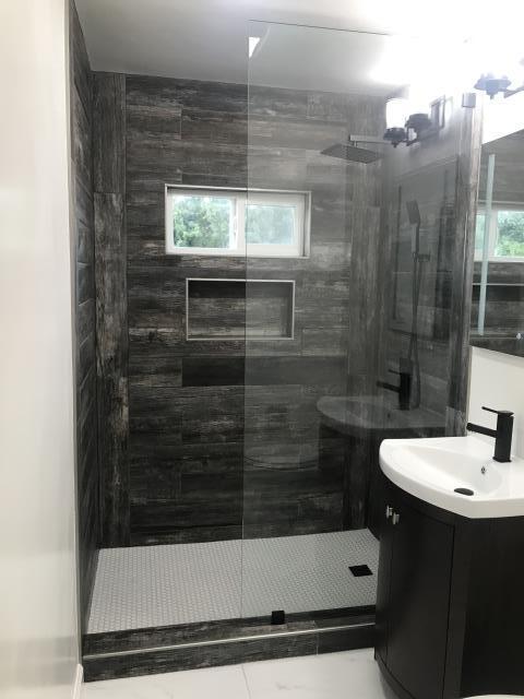 San Diego, CA - Bathroom remodel, window replacement, light framing repairs.