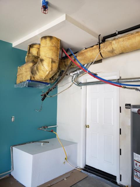 Water heater leaked into the interior hallway closet. Performed repair work to address damaged areas.