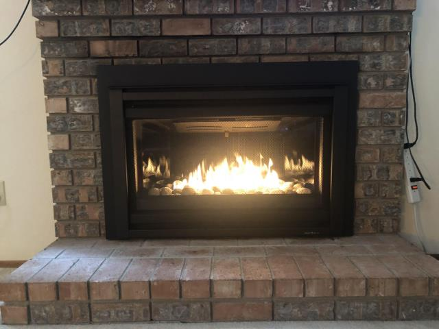Everett, WA - Installed a beautiful new Heat and Glo Cosmo Modern Gas Fireplace Insert with river rock media, blower fan assembly and IntelliFire remote for a great update to an existing fireplace for a great client in Everett WA!