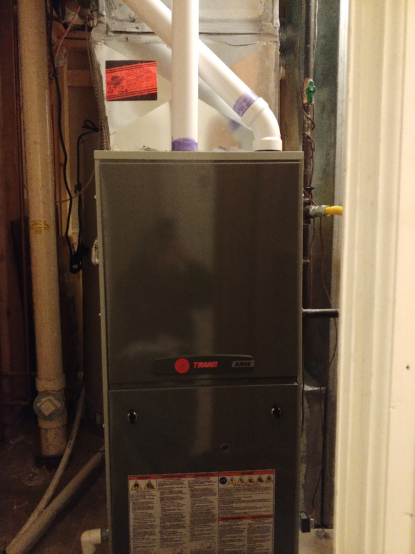 Littleton, CO - Preforming a tune up cleaning on a one year old Trane furnace.
