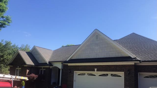 Charlotte, NC - Completed roof replacement and gutter replacement due to storm damage that was paid for by an approved insurance claim.