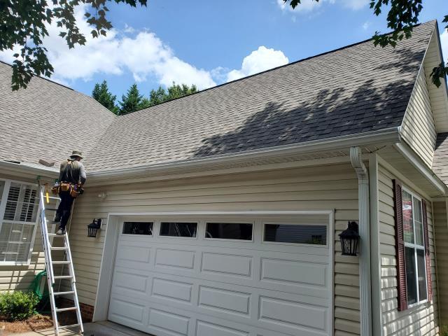 Winston-Salem, NC - Working on a gutter installation.