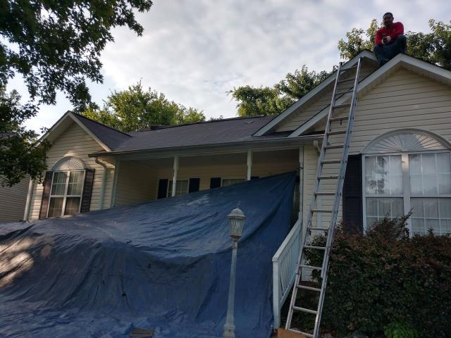 Concord, NC - Working on replacing a storm damaged roof.