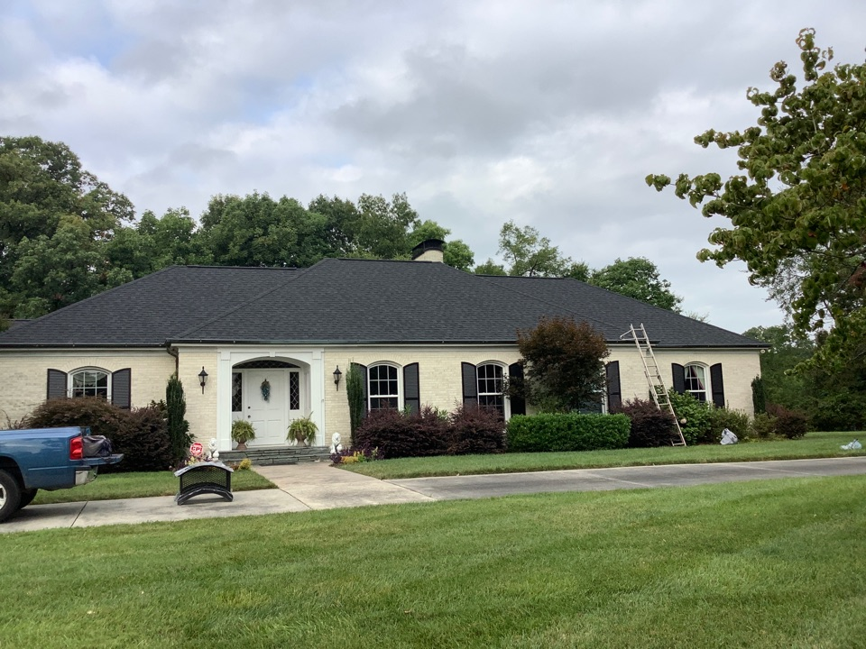 Concord, NC - Awesome morning at ERT! We are completing the finishing touches on Brandi's new roof. Today we are installing 2 new custom chimney caps and a beautiful cupola.