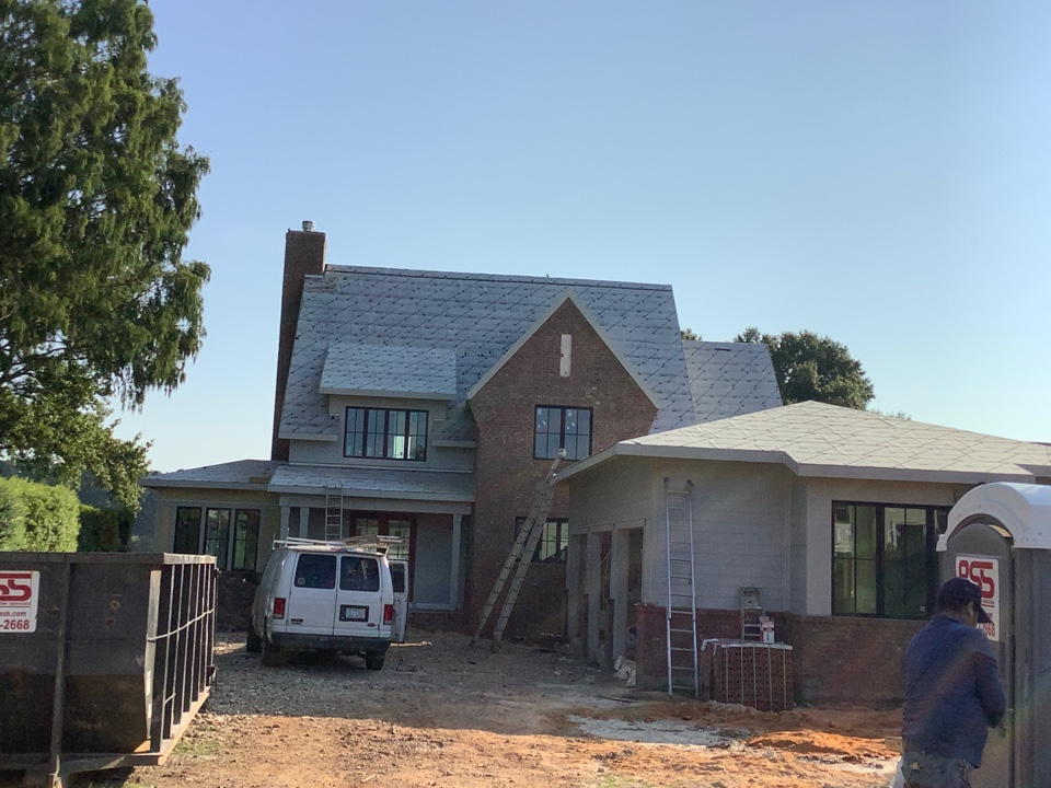 Cornelius, NC - Got to love Fridays. Getting ready to install a 90SQ metal roofing system. We are the expERTs when it comes to roofing.