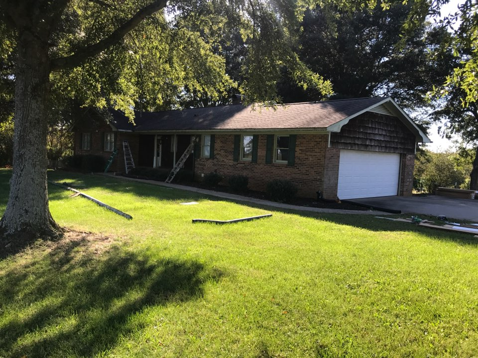 """Mocksville, NC - Covering fascia freeze boards and porch beams with PVC trim coil, soffits with t4 vinyl, and gable ends with vinyl shake siding.  Once completed we will be installing new 6"""" gutters with our leaf-free system. Stay tuned...."""