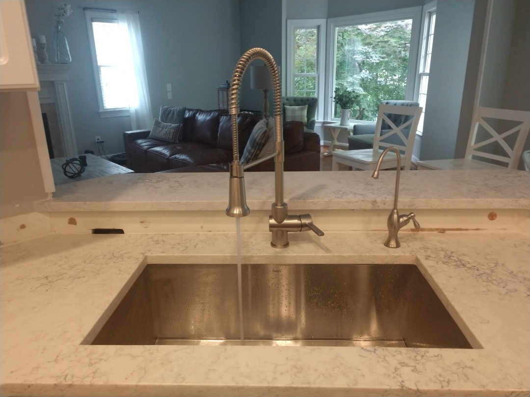 Raleigh, NC - Plumber in Raleigh installed a new kitchen faucet and drains. Now the homeowners can enjoy their new countertops.