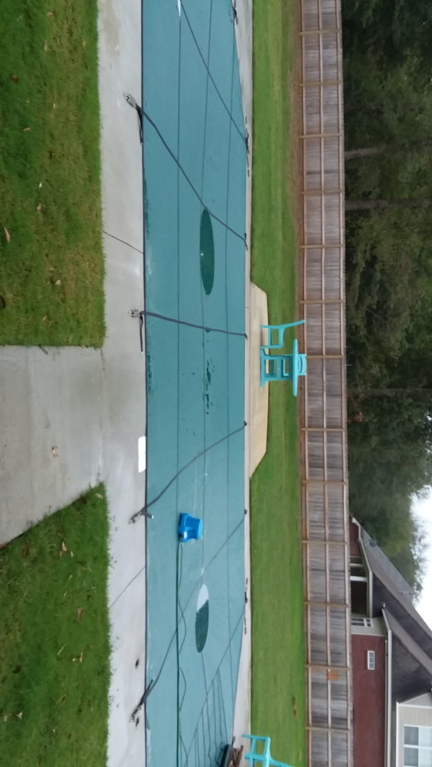 New swimming pool construction and  safety cover installation.