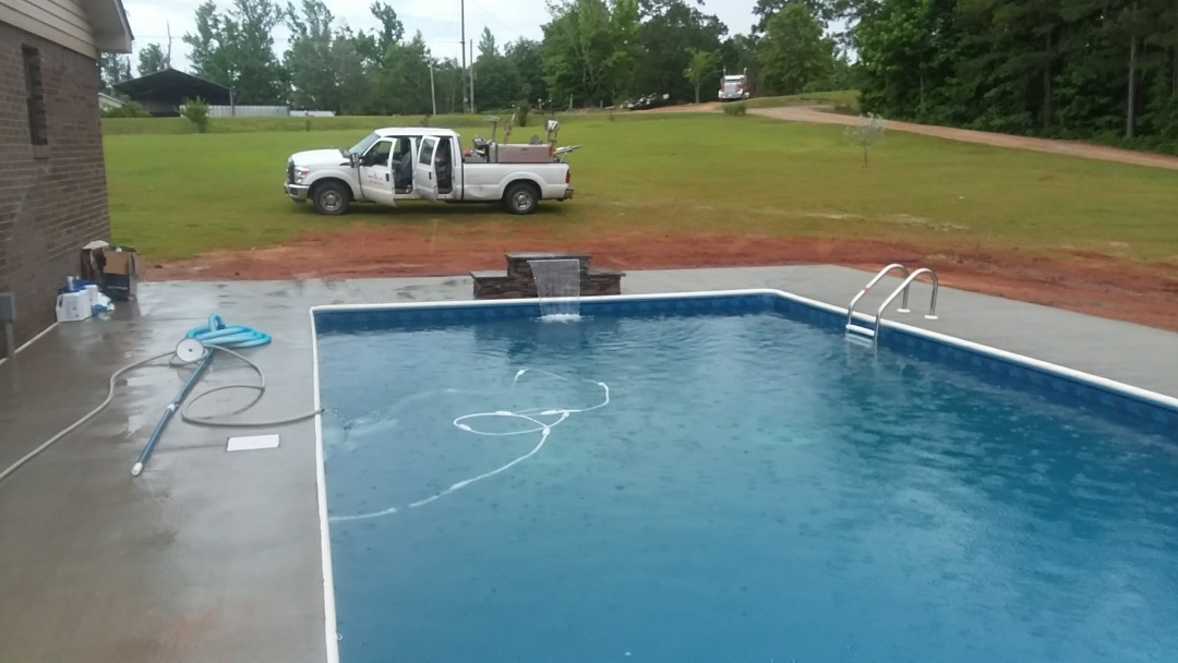 New pool installation with custom jump rock
