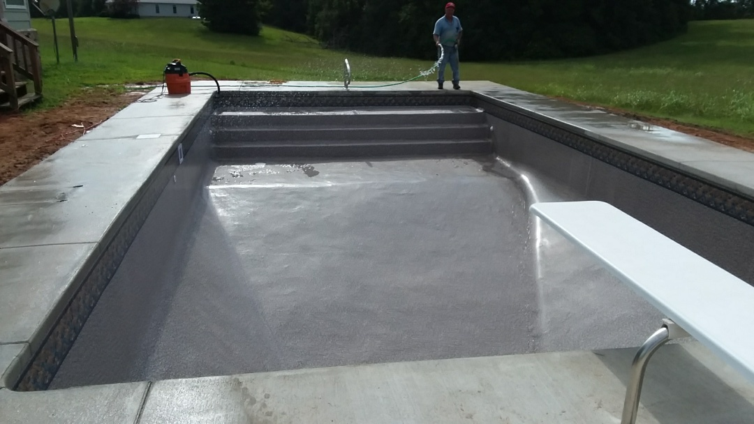 New 18x36 rectangle pool installation with liner over stairs.