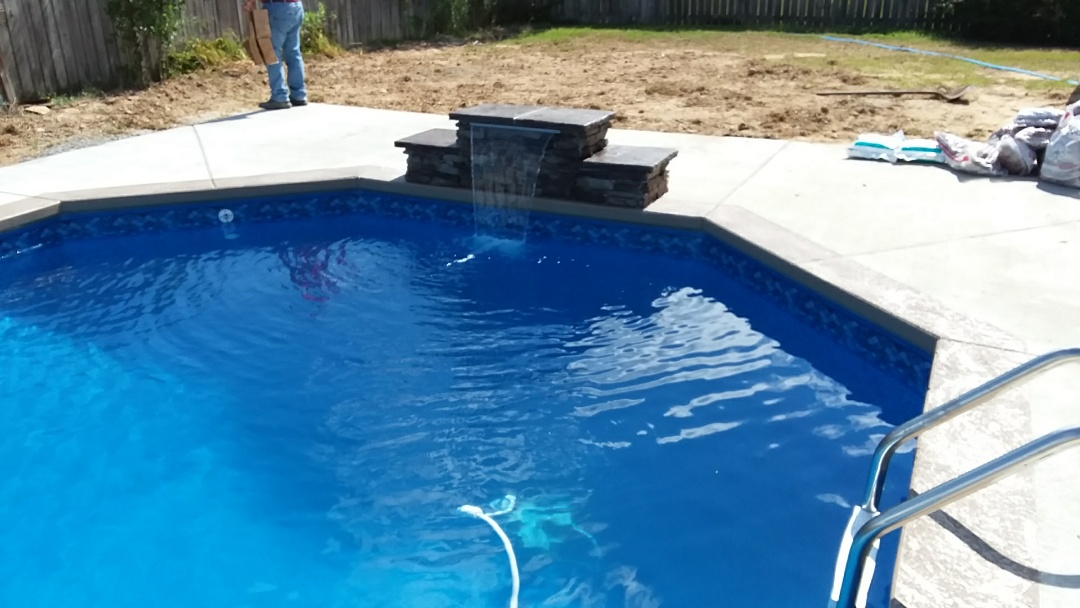 Tuscaloosa, AL - New 16x32 swimming pool installation with custom jump rock.