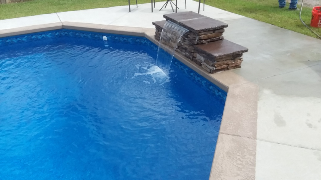 Tuscaloosa, AL - New 16x32 grecian pool with custom splash rock fountain.