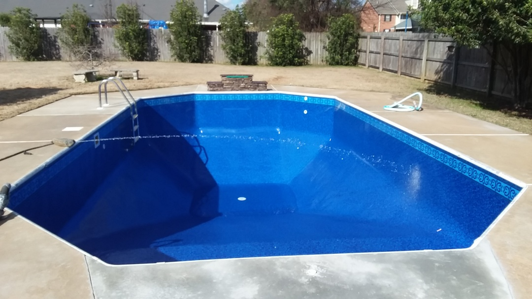 New swimming pool construction, remodel and waterfall installation.