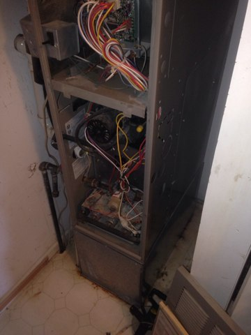 Topeka, IN - Taking care of a noise issue on a Janitrol furnace.