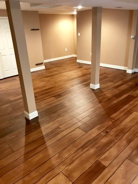 Martinsburg, WV - Tailored Concrete Coatings can make really beautiful real looking wood floor coatings! It's seriously amazing the quality they are able to achieve! Well-mannered individuals and very professional. I would say hard workers that know how to get the work done the right way. Very pleased with the way this wood floor turned out!